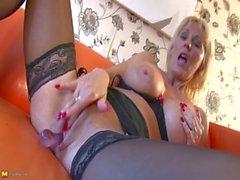 Jan Burton british mature plays with her cunt