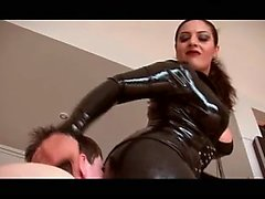 Sexy slender brunette mistress in latex displays her fabulous skills