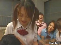 Asian schoolgirl get wet and wild in a pool