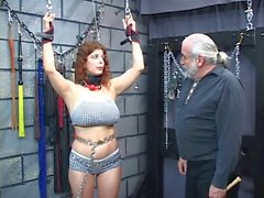 Redhead slave gets punished in brick room