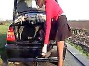 Sizzling slut inserts large thing near her vehicle