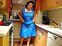 mature sexy bbw from desirebbws trying on aprons