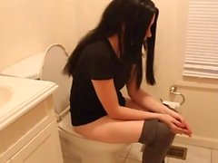 Skinny MILF on toilet 2