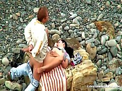 Couple having hardcore sex on the beach