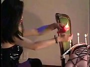 Dominatrix ties up her slave and tortures her with wax and
