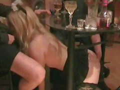 Young, busty, blonde chick loves sucking two cocks at the bar
