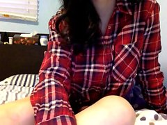 Attractive brunette teenager doing a solo striptease act