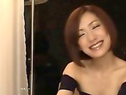 Sweet beauty from Japan gives a naughty blow to a big cock