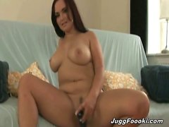Amazing brunette slut with big natural juggs spreads her