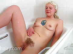 Sexy blond taking a bathroom