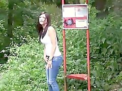 Brunette using a pass way as her own toilet