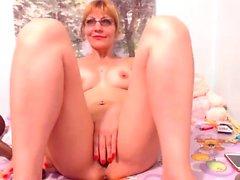 Blonde Kiara with sexy tattoo masturbates