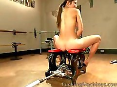 Brunette bitch positions herself on the sybian for DP