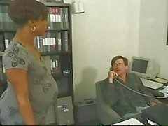 Pregnant ebony takes white cock in the office