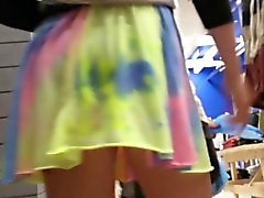 Blond teenager in dress that is brilliant upskirt