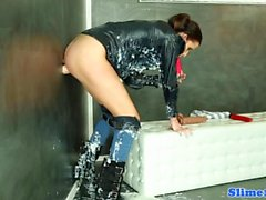 Bukakke covered babe toys pussy at gloryhole