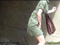 Asian babes pee outdoors