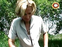 Mature blonde slut pisses outside and shaves her hairy pussy