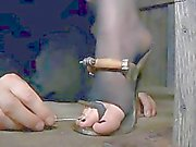 Clamped up cutie receives her fuck holes tortured
