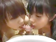 Two enticing Asian teens drive a big stick to orgasm with t