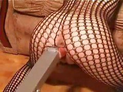 Sexy redhead in fishnet masturbates