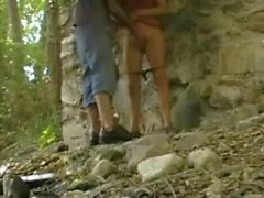 Teen couple masturbating each other under a bridge