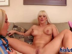 Two busty blondes pleasure each other's twats