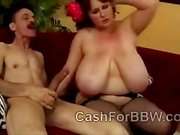 Chunky redhead with amazing tits in stockings takes meaty piece