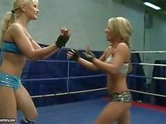 Two blonde lesbians doing some muffdiving in wrestling ring