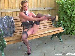 Kinky Milf Holly Kiss takes off PVC mac wanks openly on public bench in nylons garters and stilettos