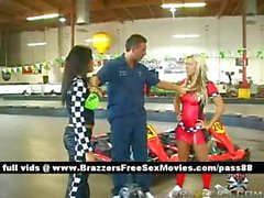 Two hot babes at a car circuit