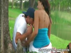 Pervert guy caught a pretty gf sucking and riding her lovers cock in the park