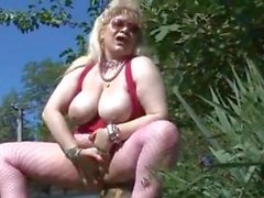 fat mature in fishnets masturbates outdoors