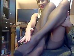 footjob by girl in black pantyhose