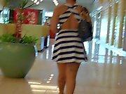 Stuck Up Tatooed Fine Ass Redbone In Short Skirt.