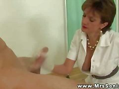 Big titted milf tugs dick and shows ass for this lucky guy