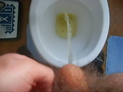 Peeing nude