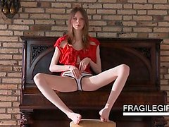 Horny sex angel teen strips sensually on a chair