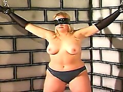 Horny sadist ties his busty blonde slaves big boobs