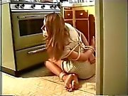 Blonde tied on the floor