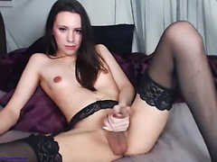 Busty brunette in lingerie and stockings fingers pussy