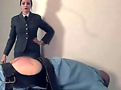 Uniformed dominatrix canes useless sub