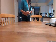 Teen masturbates on the kitchen table