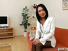 Dell'ufficio della signora giapponese di i collant