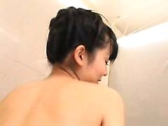 Big breasted Oriental beauty with a splendid ass gives a ho
