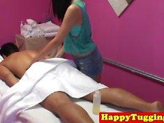 Asian handjob masseuse Gina tugging client
