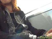 Asian peeing on train