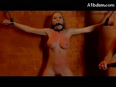 Busty Blonde Chained To Wall Mouthgag Nipple Clips Whipped Pussy Stimulated With Vibrator By Master In The Dungeon