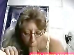 Nerdy cam milf eats a big boner