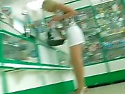 beautiful legs in high heels running to the store
